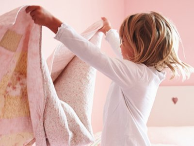 child making bed
