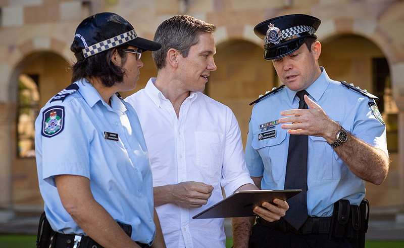 UQ researcher with QPS officers