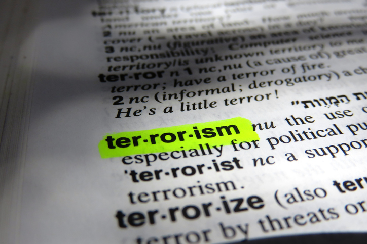 terrorism definition highlighted yellow