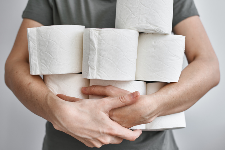man holding toilet paper