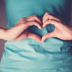 woman's hand in shape of heart