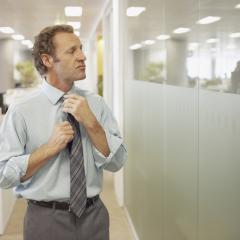 businessman straightening his tie