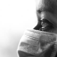Black and white photo of person wearing mask