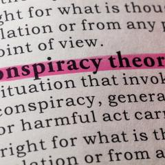 definition of conspiracy theory in a dictionary