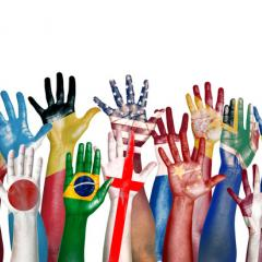 hands painted with flags