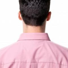man in pink collared shirt